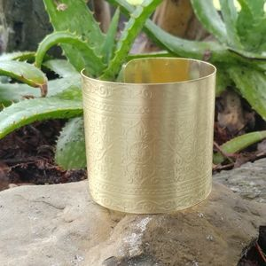 Jewelry - Large gold Wonder Woman embossed cuff bracelet